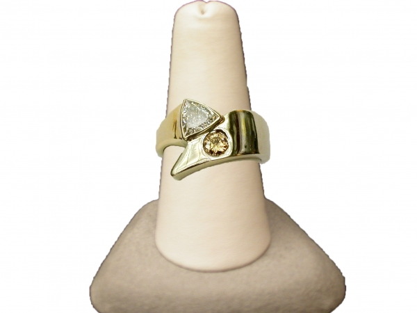 Men's diamond ring - 14k two-tone gold men's ring set with 0.25 ct round brilliant champagne diamond and 1.07 ct trilliant cut white diamond2.32 cttw. Please call for current price.