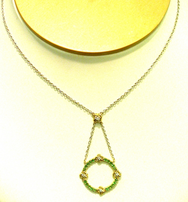 Tsavorite Pendant - Tsavorite garnets set in 14KY gold pendant with diamond accents. January birthstone. Please call for current price.