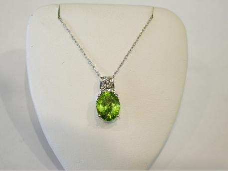 Peridot pendant - Oval checkerboard cut peridot set in 14k white gold pendant. August birthstone. Please call for current price.