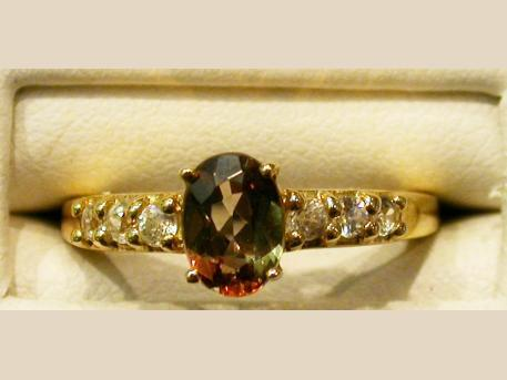 Andalusite Ring - Andalusite set in 14ky gold ring with zircon accents. Please call for current price.