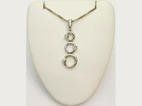 Sterling Silver Pendant - Sterling silver pendant with diamond accents by Kate McCullar. Please call for current price.